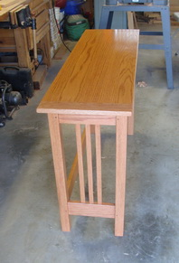 This is a clean little mission-style table in oak.